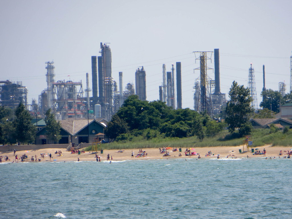 The Whiting Refinery operated by BP rises behind Whihala Beach in Whiting, Indiana.